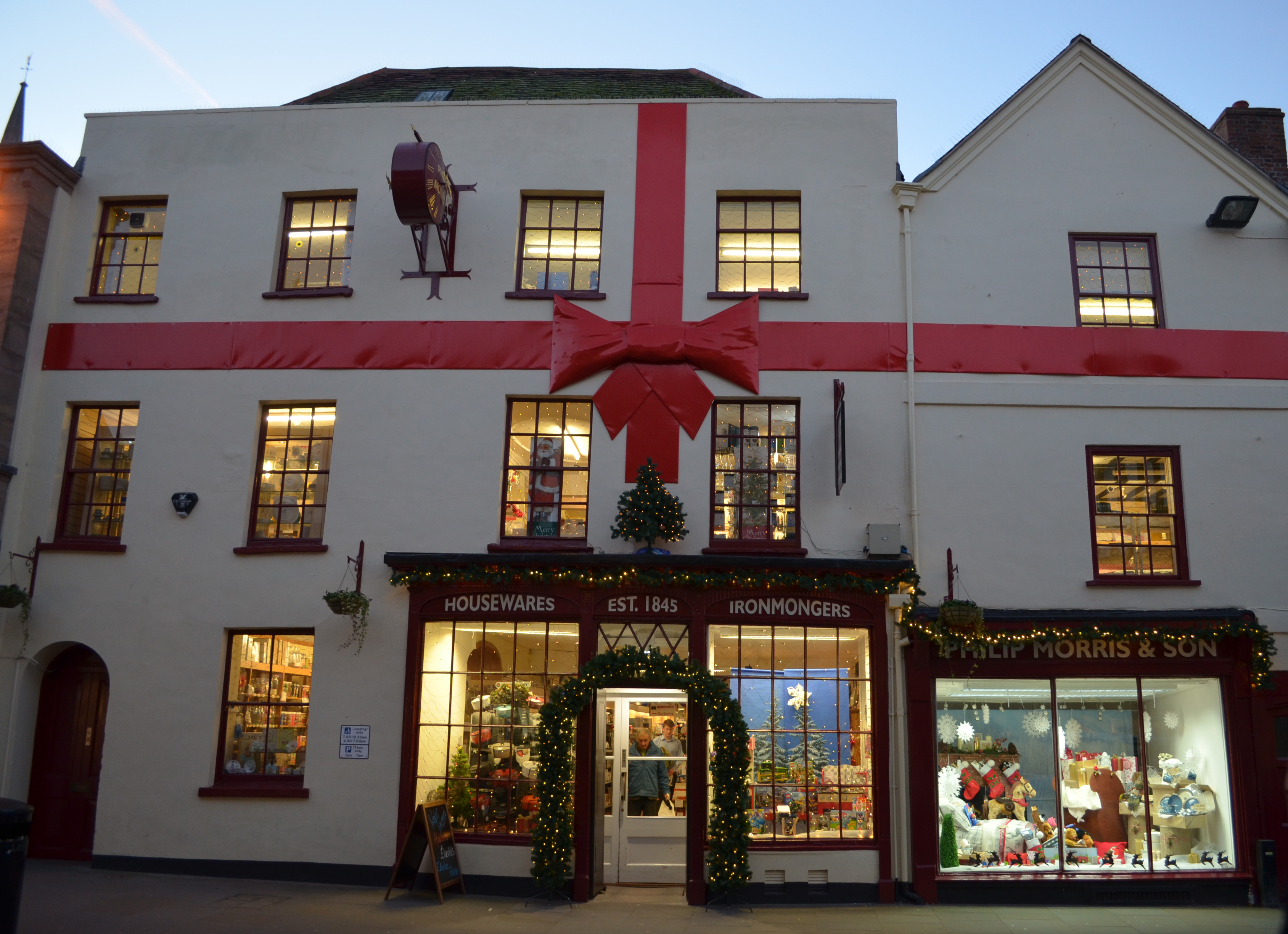 Philip Morris and Son Hereford wrap Christmas up this year with a giant bow and ribbon on their 500+ year old building!