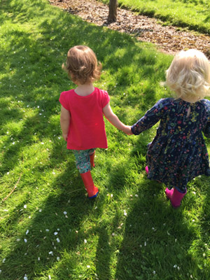 Two little ladies enjoying a walk in the sunny weather